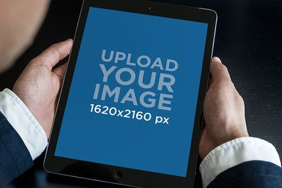 Over The Shoulder Mockup of a Man Holding an iPad in Portrait Position 2041-el1