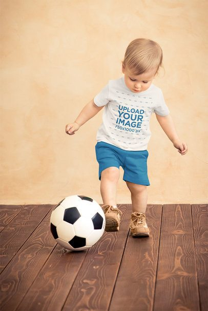 T-Shirt Mockup of a Little Kid Playing with a Soccer Ball 34406-r-el2