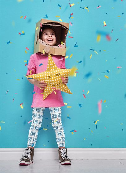 Leggings Mockup of a Little Girl with a Cardboard Helmet in a Confetti Rain Setting 34572-r-el2