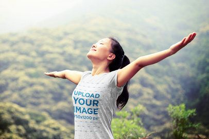 T-Shirt Mockup of a Joyful Woman Spreading Her Arms in Nature 34559-r-el2