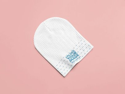 Mockup of a Beanie Laid Flat on a Surface 25342