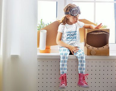 T-Shirt Mockup of a Girl with Leggings Playing with a Cardboard Astronaut Helmet 34576-r-el2