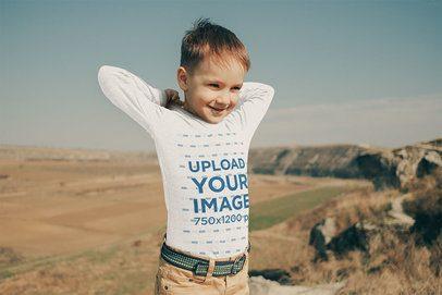 Mockup of a Kid Wearing a Long Sleeve Tee at a Meadow 34141-r-el2