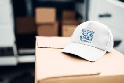 Mockup of a Dad Hat Lying on a Cardboard Box 34646-r-el2