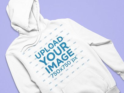 Front-View Mockup of a Hoodie Flat Laid on a Solid Surface 25547