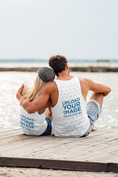 Back View Mockup of a Couple with Tank Tops Hugging at The Beach 34199-r-el2