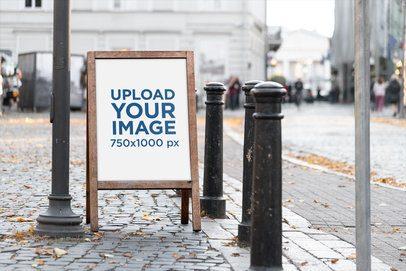 Mockup of a Wooden A-Frame Sign Placed on a Sidewalk 4124-el1