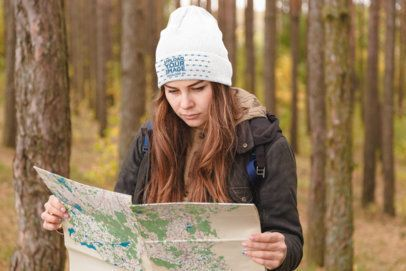 Beanie Mockup of a Woman in the Woods Looking at a Map 34528-r-el2