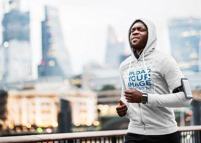 Mockup of a Running Man Against a City Landscape 34284-r-el2