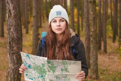 Beanie Mockup of a Woman at the Woods with a Map 34527-r-el2