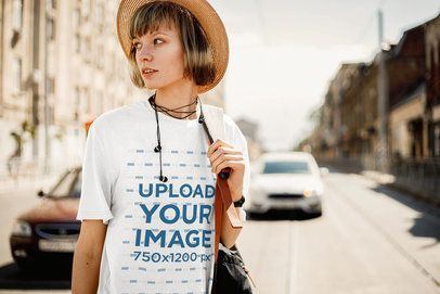 T-Shirt Mockup of a Stylish Woman Standing in the Street 34687-r-el2