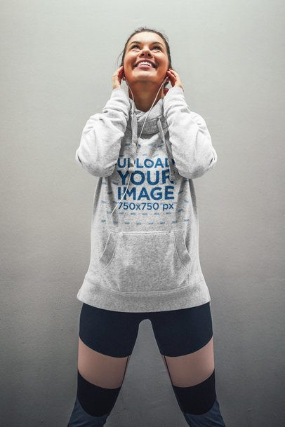 Mockup of a Woman with a Heathered Hoodie Happily Listening to Music 34175-r-el2