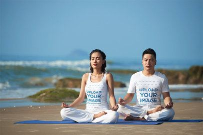 Mockup of a Woman with a Tank Top and a Man with a T-Shirt Meditating at the Beach 34231-r-el2