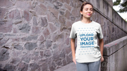 Video of a Woman Posing with a T-Shirt in an Urban Scenario 13051
