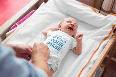 Onesie Mockup Featuring a Crying Newborn 34627-r-el2