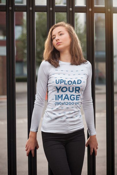 Long-Sleeve Tee Mockup of a Young Woman Posing by a Metal Fence 4331-el1