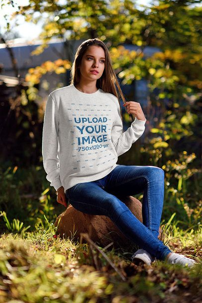 Crewneck Sweatshirt Mockup of a Woman Sitting on a Rock in the Woods 4351-el1