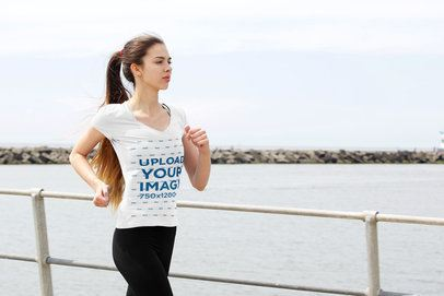 V-Neck Tee Mockup of a Female Jogger by a Pier 34801-r-el2