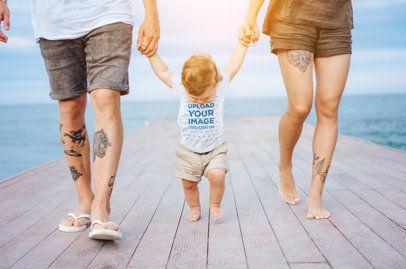 T-Shirt Mockup of a Baby Walking on the Beach with His Parents 34296-r-el2