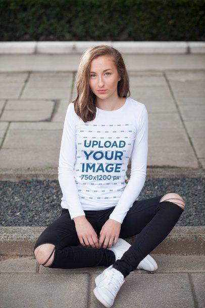 Long Sleeve Tee Mockup of a Young Woman Sitting on a Sidewalk 4332-el1