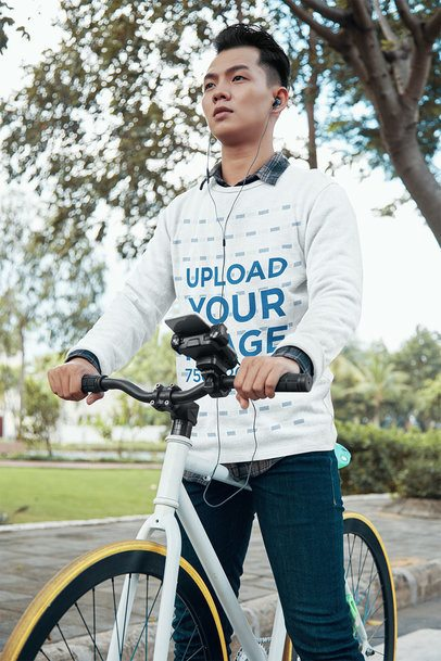 Crewneck Sweatshirt Mockup of a Man Riding a Bike in the Park 34215-r-el2