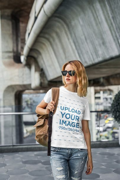 Mockup of a Woman Wearing a Round-Neck T-Shirt in an Urban Setting 4322-el1
