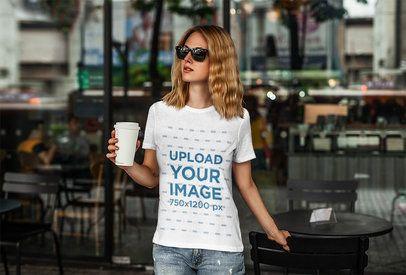 T-Shirt Mockup of a Woman at an Urban Cafe 4325-el1