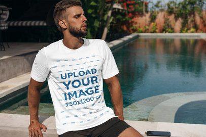 T-Shirt Mockup of a Bearded Man Sitting by a Pool 4348-el1
