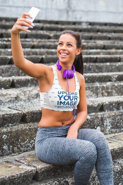 Mockup of a Woman in a Sports Bra Taking a Selfie by a Stairway 34292-r-el2