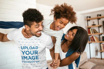 T-Shirt Mockup Featuring a Father Playing with His Wife and Daughter at Home 34309-r-el2
