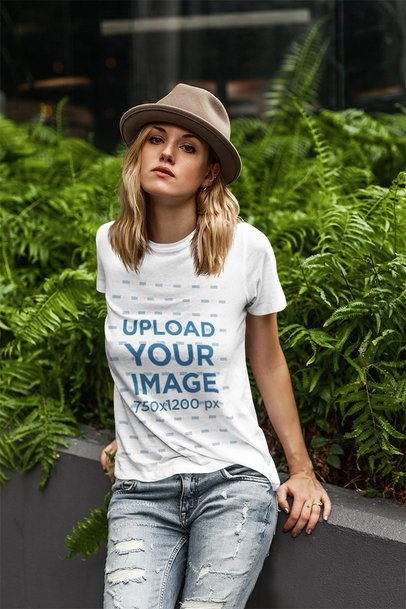 Mockup of a Woman with a Basic Tee Posing by Some Plants 4327-el1
