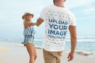 Back-View Tee Mockup of a Man Holding Hands with His Girlfriend at the Beach 34368-r-el2