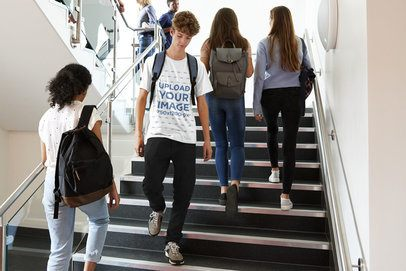 T-Shirt Mockup of a Teenager Walking Down College Stairs 34545-r-el2