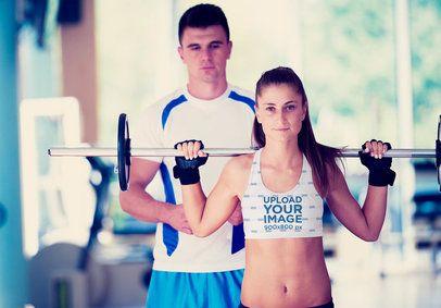 Sports Bra Mockup of a Fit Woman Lifting Weights 34449-r-el2