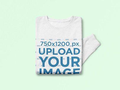 Mockup of Folded Sweatshirt on a Colored Surface 4359-el1