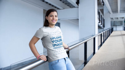 T-Shirt Video of a Woman Smiling on a Building Runway 12982