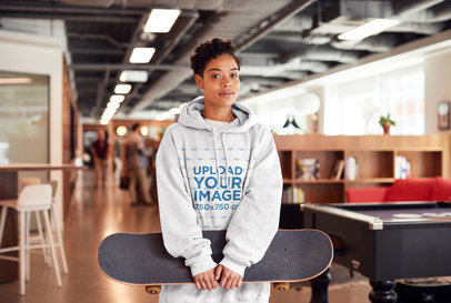 Heather Pullover Hoodie Mockup of a Woman Holding a Skateboard 34553-r-el2