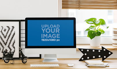 Mockup of an iMac Featuring a Cozy Home Office Workspace 36941-r-el2