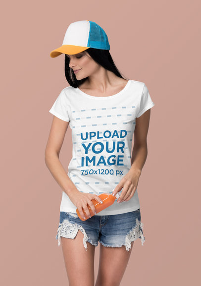 T-Shirt Mockup Featuring a Woman Holding a Bottled Juice at a Studio 4365-el1