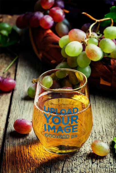 Mockup of a Stemless Wine Glass Surrounded by Fresh Grapes 36696-r-el2