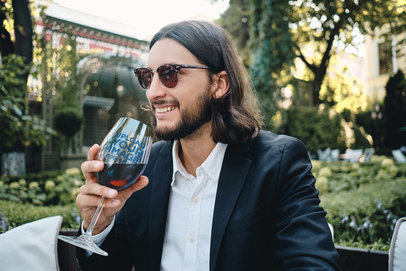 Wine Glass Mockup Featuring a Stylish Man at a Restaurant 36576-r-el2