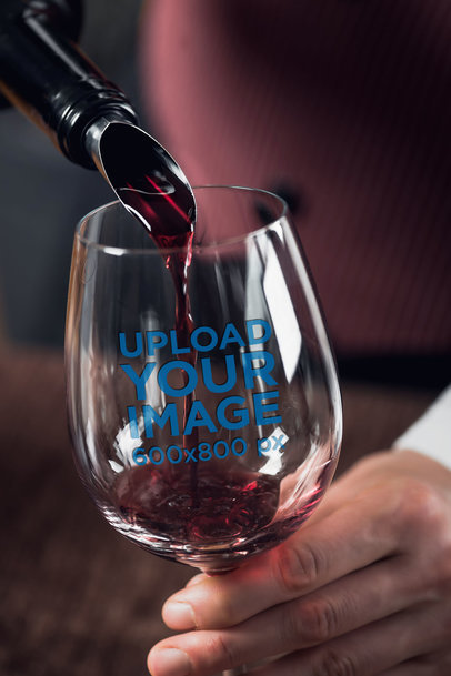 Mockup of a Man Pouring Wine in a Stemless Wine Glass 36811-r-el2