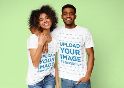 T-Shirt Mockup of a Happy Young Couple Posing at a Studio 34540-r-el2