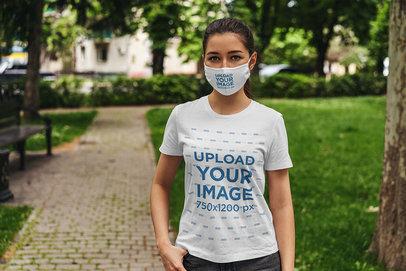 Mockup of a Woman Wearing a Face Mask and a T-Shirt at a Park 4560-el1