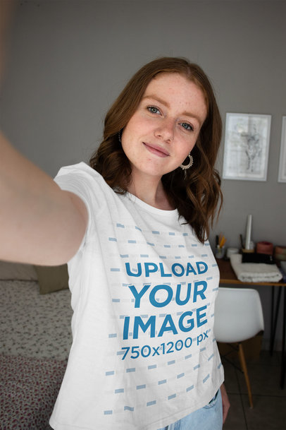 Selfie Mockup of a Woman Wearing a Round-Neck T-Shirt in Her Bedroom 36765