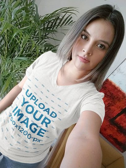 Mockup of a Woman with a Heathered V-Neck Tee Taking a Selfie at Home 36762