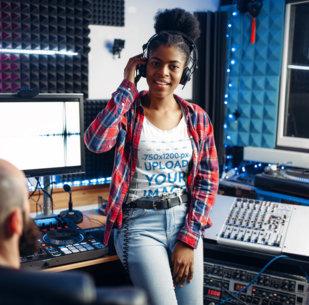 Mockup of a Woman Wearing a T-Shirt in a Music Studio 36969-r-el2