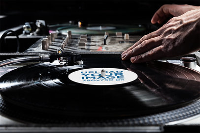 Vinyl Record Mockup of a DJ Playing a Set 4528-el1