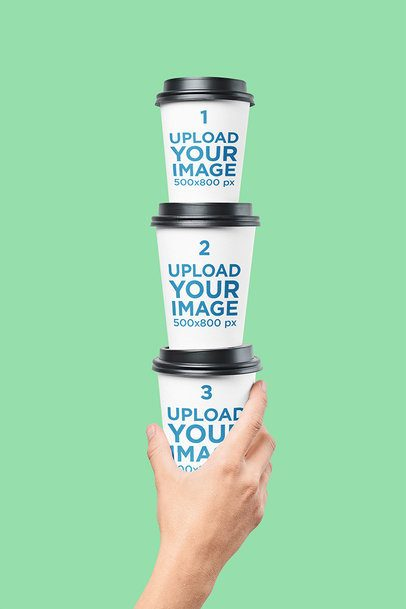 Mockup Featuring a Man's Hand Holding a Pile of Coffee Cups 36653-r-el2