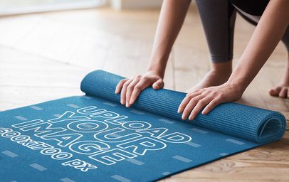 Mockup of a Woman Rolling Up Her Sublimated Yoga Mat 37074-r-el2